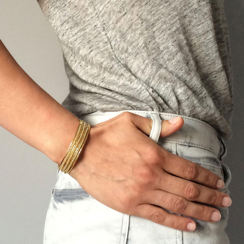 bracelet semainier lignes et perles plaque or jaune